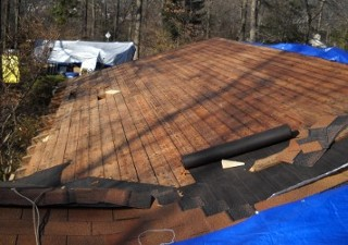 other half of the roof cleared after shingles done on first half