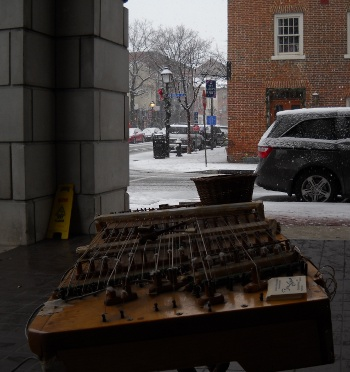 The dulci set up in old town as snow falls, looking across it legtwise from one end