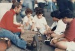 playing the dulcimer sitting on the sidewalk many years ago with kids sitting in front of me