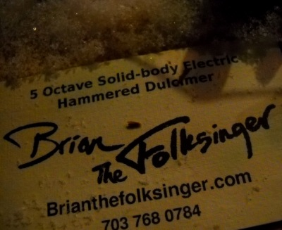Brian the Folksinger business card on the dulcimer in the snow