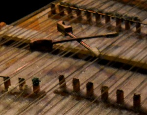 dulcimer hammers resting on the strings above the snow-covered dulcimer