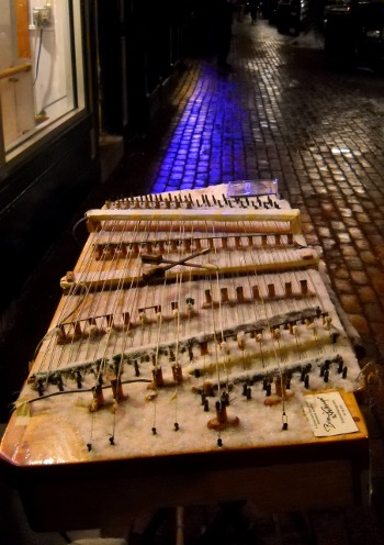 snowy dulcimer setup on the street at night