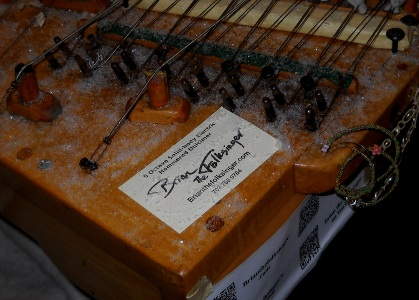 brian the folksinger business card on snowy dulcimer at night