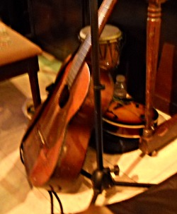 dulcimer, mandolin,and drum by the piano at Epicure Cafe