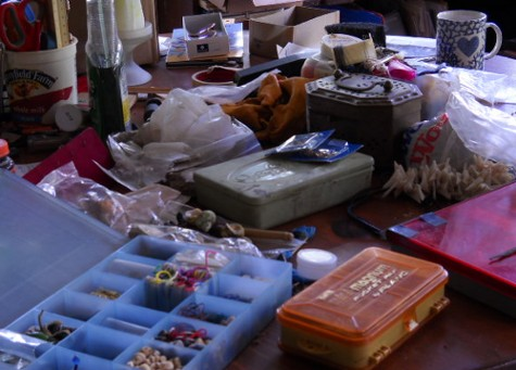 my old junk spread on a table while repacking