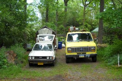 the van and toyota in the driveway at 1213