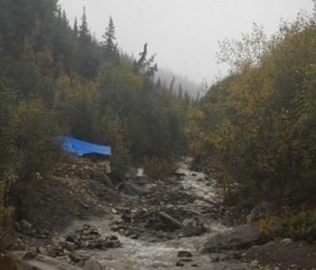 wilderness camp, tarp along the creek