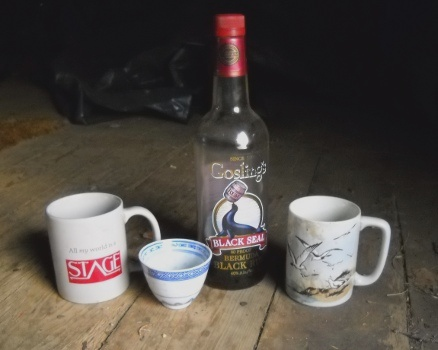 rum, cups from my parents, and the cup of rememberance on tha cabin floor in Alaska
