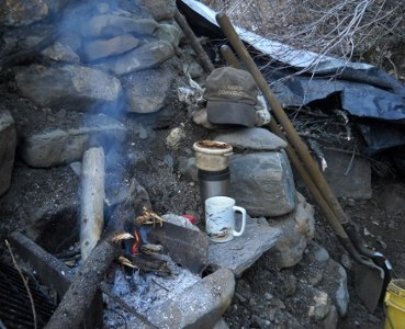 hearth at the dig with fire and seagull cup