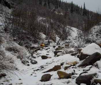 the creek wth sluice and bucket, covered in heavy snow