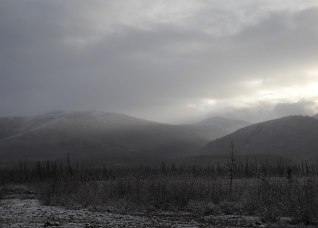 snowstorm and light in arctic mountains