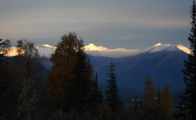 sunrise on snowy mountain