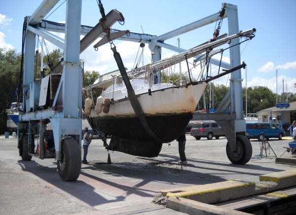 my steel sailboat in the slings at the boatyard
