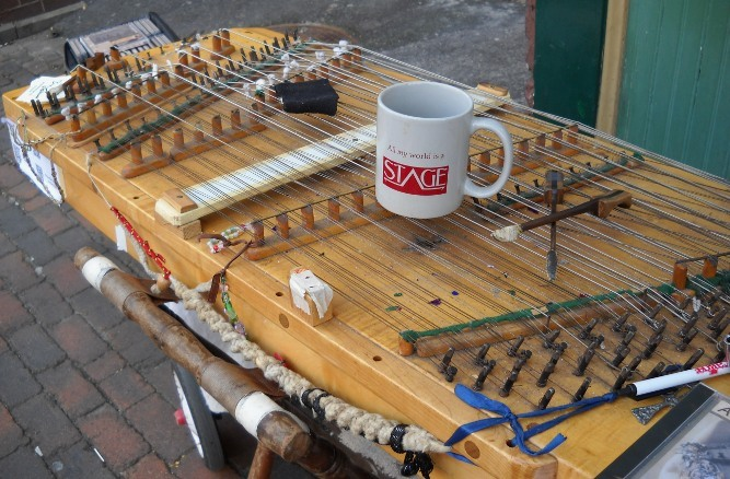 my All My World's a Stage coffee cup sitting on the dulcimer