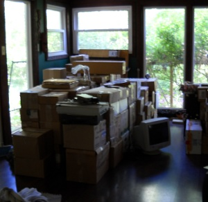the pile of boxes from the van stacked in the dining room