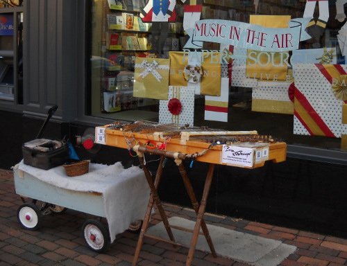 dulci on street with music is in the air in shop window display