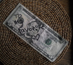 5 dollar bill with to my favorite and a heart written on it