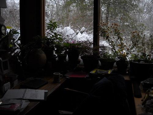 my desk and journal, snow outside the window