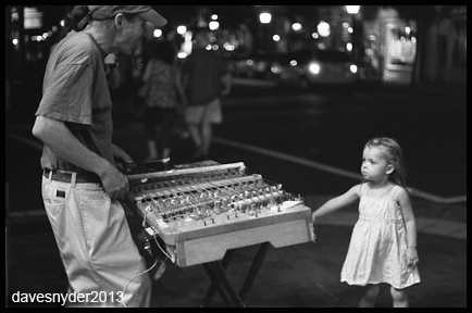 Brian performing on King Street at night, a black and white photo by David Snyder