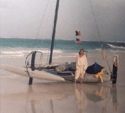 brian with the hydrofoil trimarran Further on the beach in Tullum after crossing the gulf solo