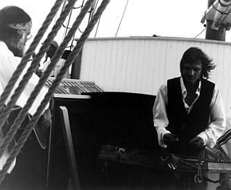 folksinger playing on deck