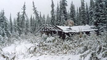 Alaska cabin in snow