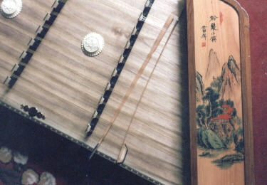 a chinese dulcimer with beautiful painted sidepanels