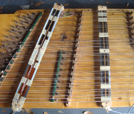 dulcimer with uncovered pickes mounted, copper coils showing