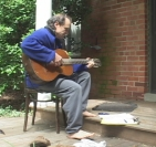 playing guitar on the porch