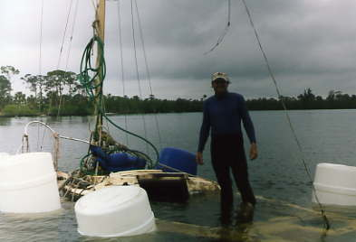 me raising my sunken sailboat